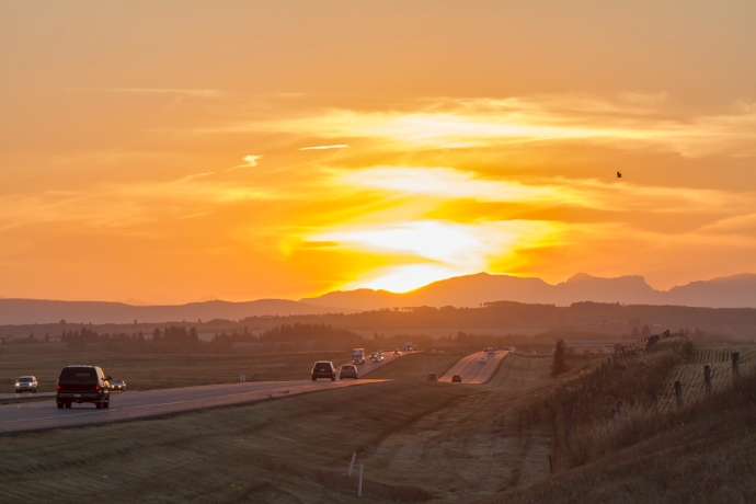 Sunset on the eve of the Autumnal Equinox, Sept 21, 2012, with the Sun setting due west at the end of westbound Highway 1 to Banff, Alberta. This is a frame from a 315-frame time-lapse movie.