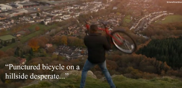 Punctured bicycle on a hillside desperate